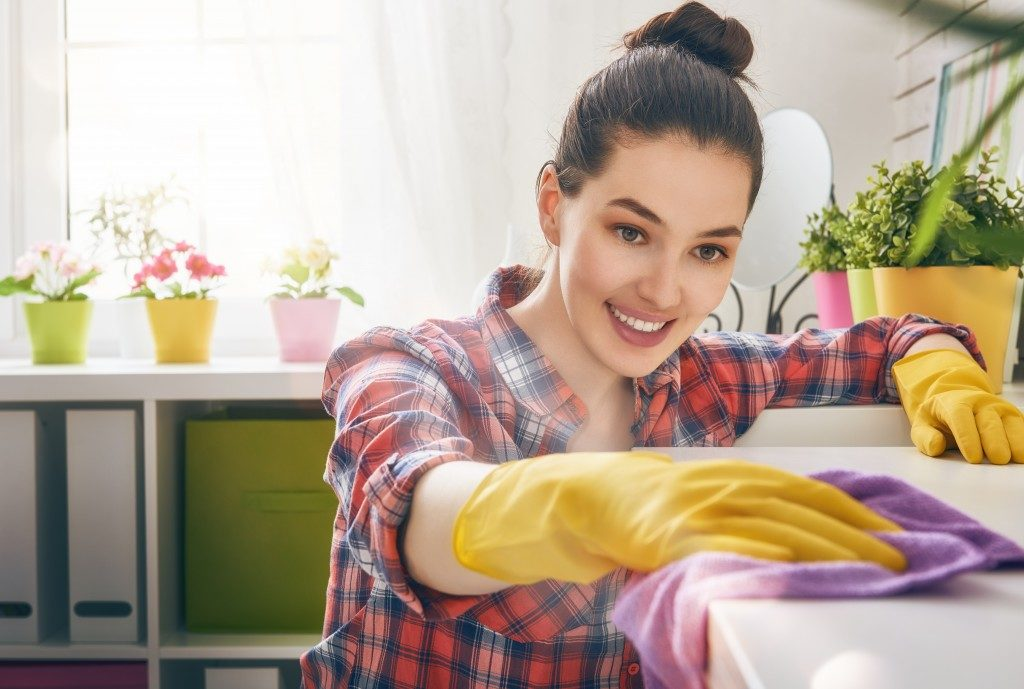 woman cleaning her own home