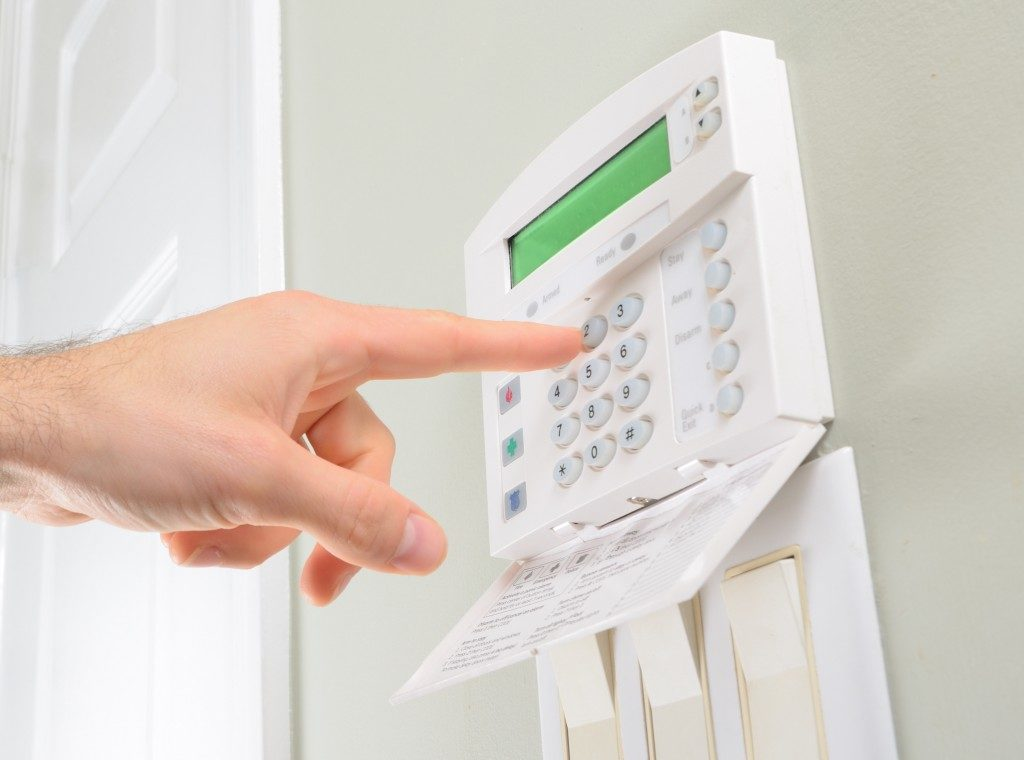Person pressing the house alarm