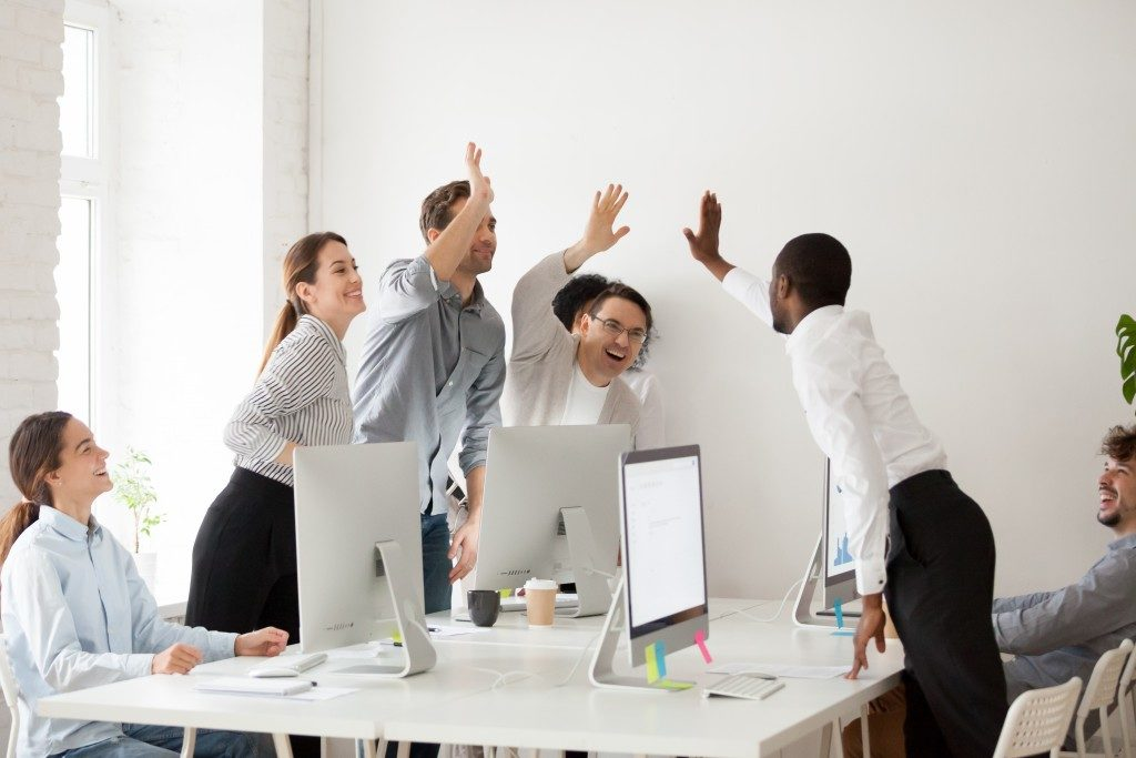 Employees giving each other high fives