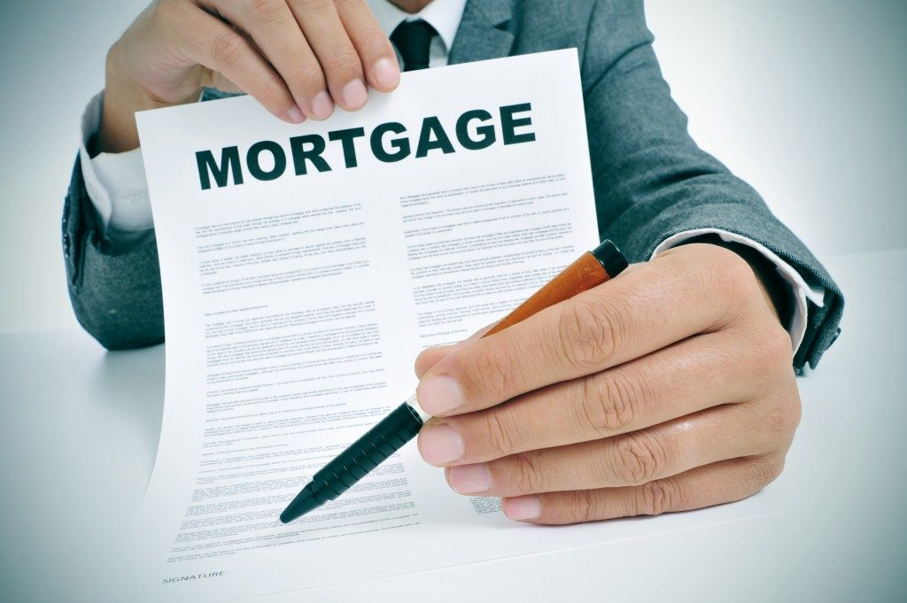 Businessman showing a mortgage loan contract