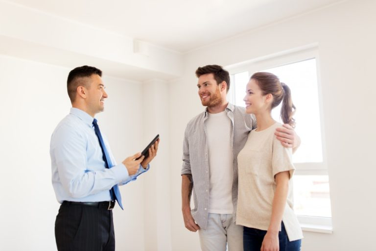 Couple with agent renting apartment