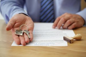 man holding keys to the house